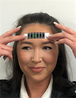 Small Forehead Thermometer  in use