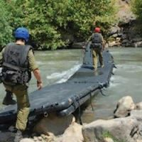 Rescue Bridge training - deployed across a river to reach the other side