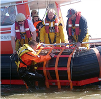 Fibrelight Recovery Cradle Climibg aboard the side of a baot